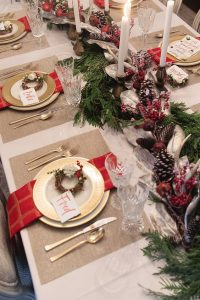 06 a traditional tablescape with red touches pinecones candles and evergreens for those who love classics