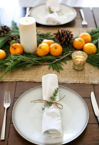 08 a burlap table runner citrus pinecones and candles are great for a rustic tablescape