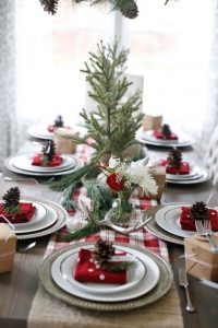 09 a cozy rustic table setting with a plaid runner antlers evergreens and pinecones for each place setting