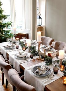 14 a chic neutral tablescape with candles evergreens deer figurines faux birds and branches