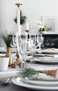 19 a modern tablescape done with pine needles brass touches gingerbread cookies and nuts